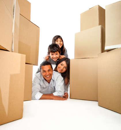 Family moving house with cardboard boxes - isolated over a white background photo