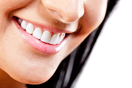 smiling teeth: Close-up to beautiful female smile - isolated over a white background Stock Photo