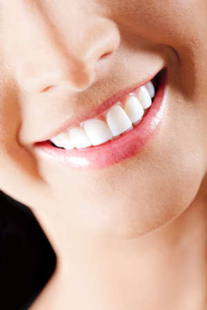 Close-up portrait of a beautiful woman smiling  photo