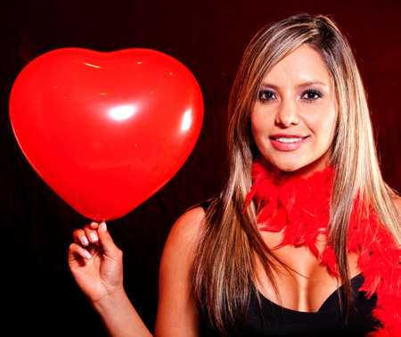 Woman holding a heart shaped balloon for Valentines Day Stock Photo - 12198180
