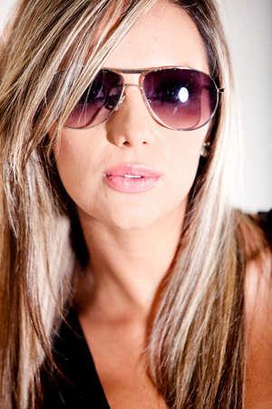 blonde hispanic: Portrait of a beautiful blonde woman with sunglasses