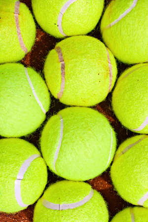 Close-up of tennis balls on a clay court photo