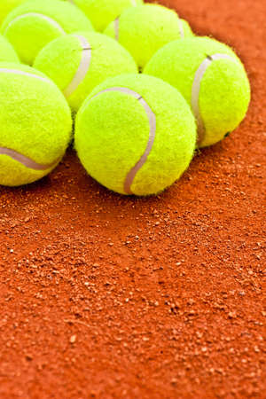 Close-up of tennis balls on a clay court  Stock Photo - 12198155