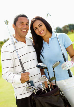 Happy couple playing golf at the club Stock Photo - 12198137