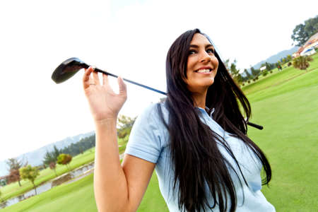 Beautiful woman playing golf at the club  photo