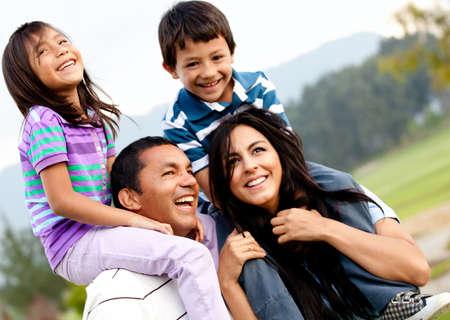 hispanic boy: Beautiful family portrait outdoors looking very happy