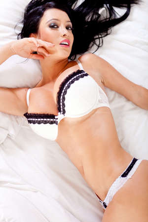 Sensual woman in sexy underwear lying on the bed photo