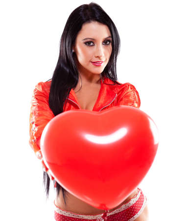 Sexy woman holding a heart shaped balloon for Valentines Day photo