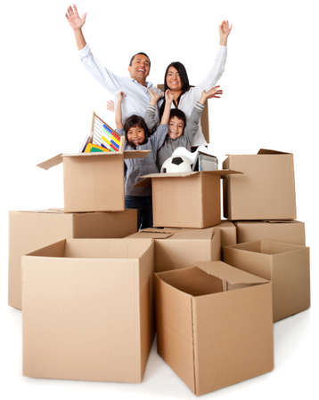 house moving: Family excited about moving with arms up and cardboard boxes