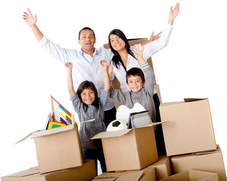 family moving house: Family excited moving house packing in cardboard boxes – isolated