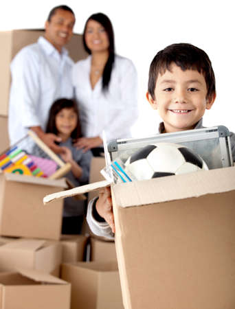 Boy with his family moving house and holding boxes- isolated over a white background photo