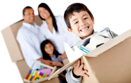 Boy moving with his family and holding a box with toys - isolated over a white background photo