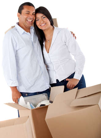 Couple moving house and packing in boxes  Stock Photo - 12198244