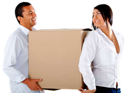 Couple moving house and carrying boxes - isolated over a white background photo