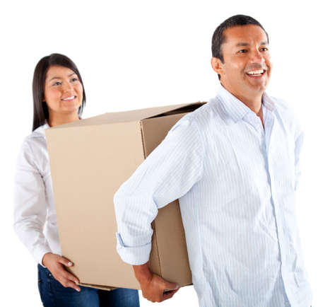Couple packing in boxes to move house - isolated over a white background photo