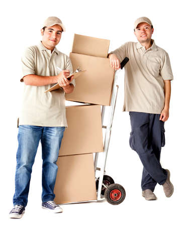 Delivery men carrying boxes with a trolley - isolated over a white background photo