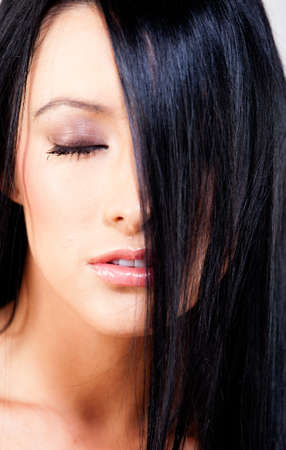 Beautiful woman with straight black hair - beauty concepts photo