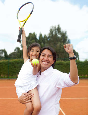 Father proud of her daughter winning a tennis match photo