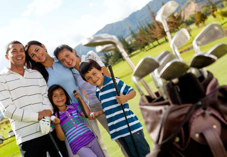 Family of golf players at the course in a beautiful day Stock Photo - 12198211
