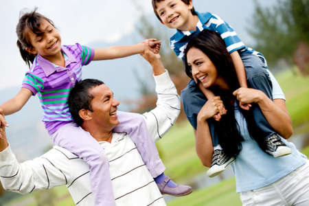 latin girls: Portrait of a happy family having fun outdoors  Stock Photo
