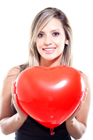 Woman holding a heart shaped balloon celebrating Valentines Day photo
