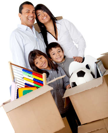 Family packing in boxes for moving house - isolated over a white background photo