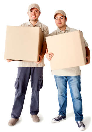 Delivery men carrying boxes - isolated over a white background photo