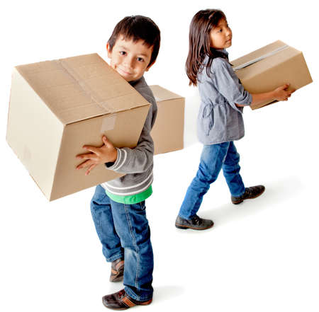 Kids moving house carrying cardboard boxes - isolated over a white background photo