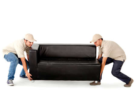 man couch: Delivery men carrying a big sofa - isolated over a white background Stock Photo