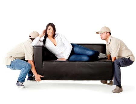 Delivery men carrying a woman lying on the sofa - isolated over a white background Stock Photo - 12198248