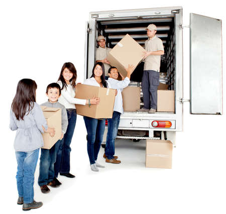 family moving house: Family moving house taking boxes into a truck - isolated over a white background