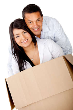Loving couple moving house and packing in boxes - isolated over white  Stock Photo - 12198247