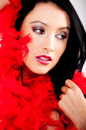 Beautiful woman portrait with a red feather boa Stock Photo - 12198329