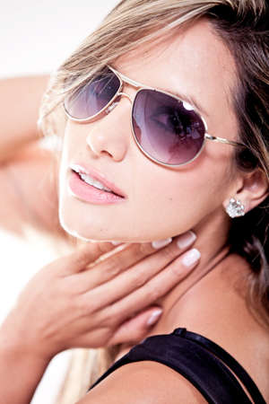 Sexy woman wearing sunglasses - isolated over a white background photo