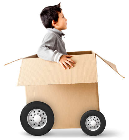 Boy in a car made of cardboard box - express delivery concepts photo