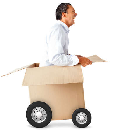 man made: Man in a car made of cardboard box - fast delivery concepts Stock Photo