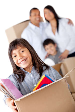 Family moving home and carrying boxes - isolated over a white background Stock Photo - 12198351