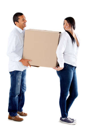 Couple moving house and carrying boxes - isolated over a white background Stock Photo - 12198347