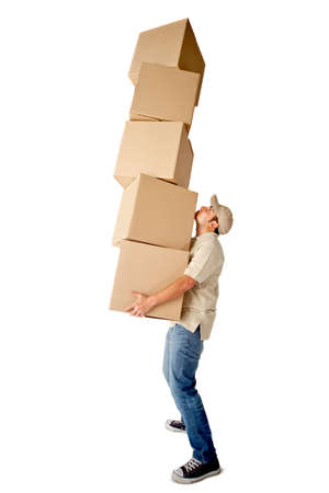 Deliveryman carrying heavy boxes - isolated over a white background photo