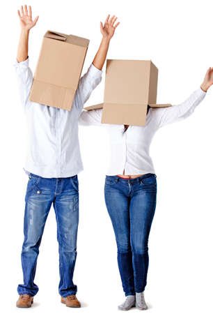 hectic: People with cardboard boxes on their heads simulating a hectic moving – isolated