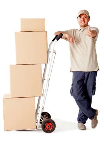 packing boxes: Delivery man carrying boxes with a trolley - isolated over a white background Stock Photo