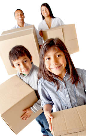 Family packing in boxes for moving home - isolated over a white background photo