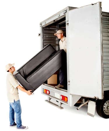 moving truck: Delivery men with unloading a sofa from a truck - isolated over white