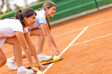 Females at a tennis competition set to run at the court  photo