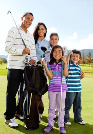 Beautiful family playing together at a golf course photo