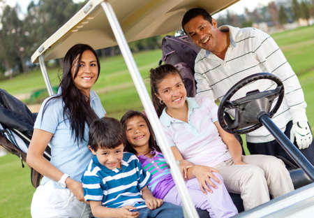 Beautiful family portrait in a cart at the golf course photo