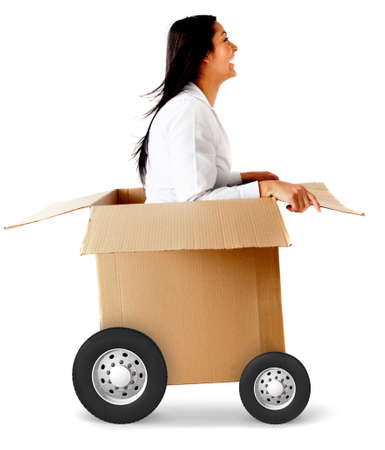 Woman in a car made of cardboard box - fast shipping concepts Stock Photo - 12198301