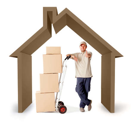 Moving services man with a 3D house - isolated over a white background photo