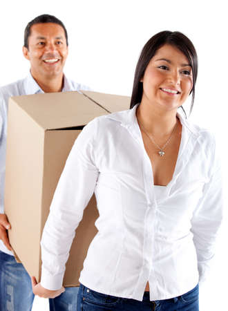 Couple moving home and carrying boxes - isolated over a white background Stock Photo - 12197897