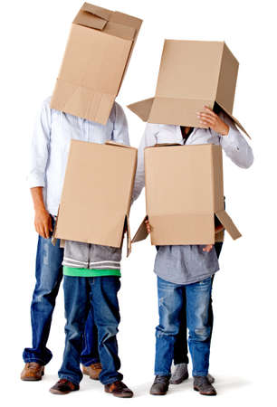 Family with cardboard boxes on their heads in a fun moving day – isolated photo